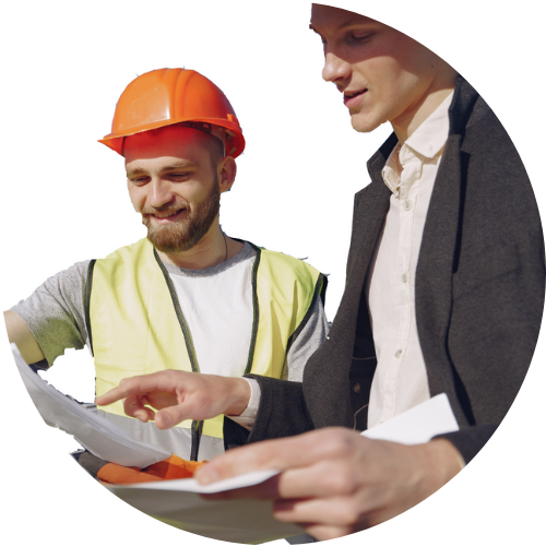 two men looking at plans