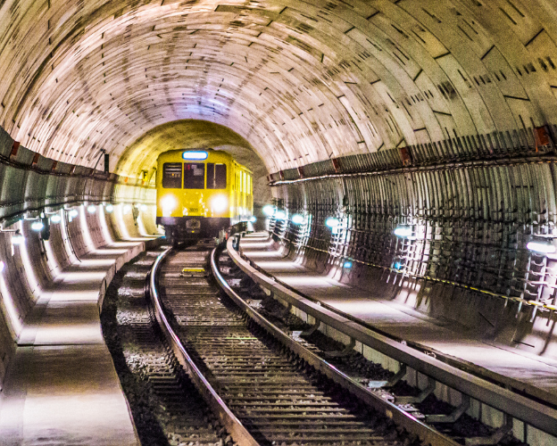 A yellow train in a tunnel